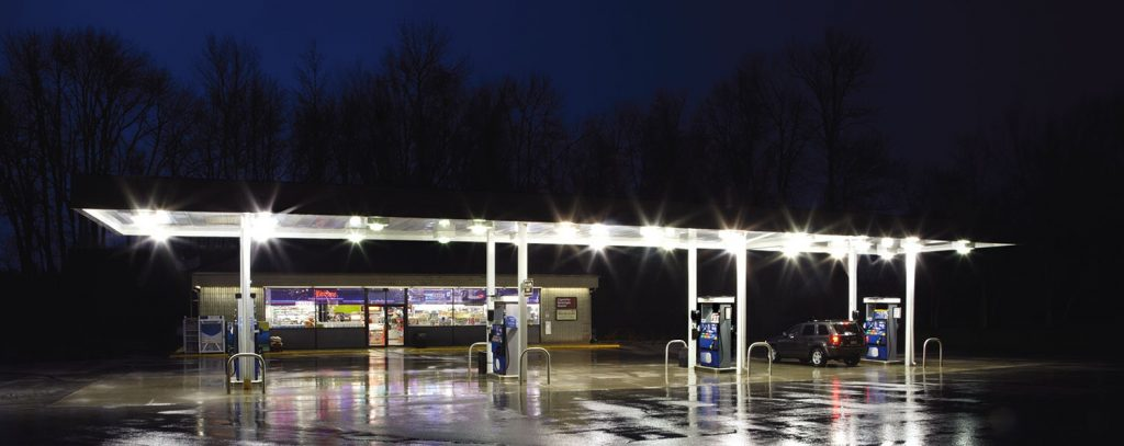 outdoor lighting - image shows a well-lit gas station at night