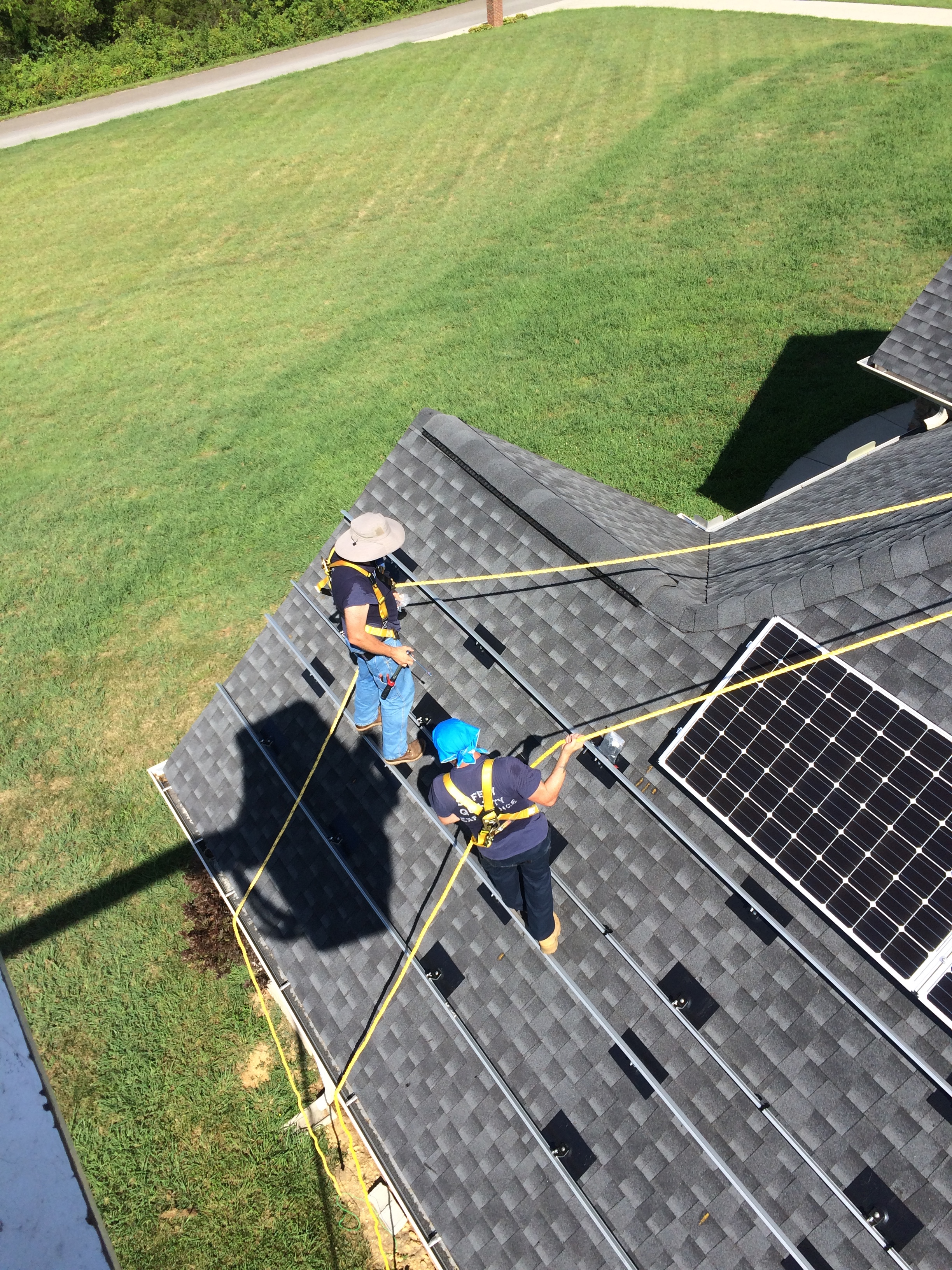 Solar in East Tennessee - The Facts - Workers on roof installing solar panels