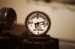 Image shows a pressure gauge to illustrate that LES Facility Service handles pneumatic, mechanical, and electrical preventative maintenance along with other services.