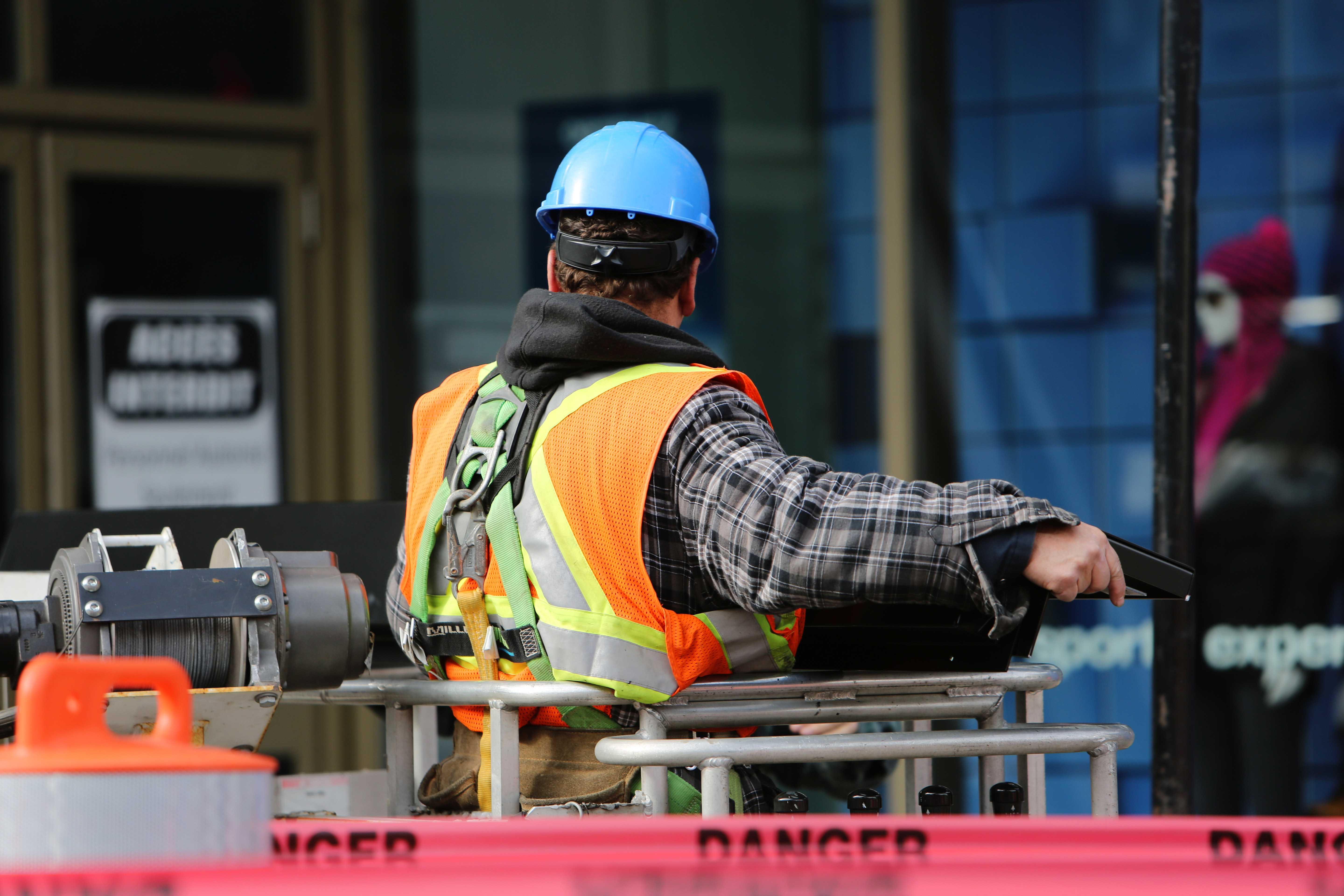 facility maintenance worker in safety gear